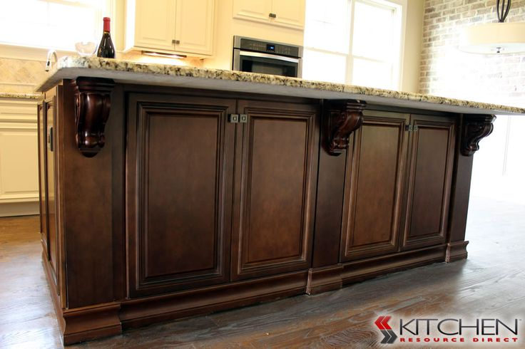 Storage on both sides of the kitchen island cabinets shown are Titusville RTA Freeport Maple