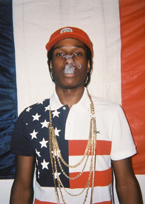 Asap Rochy wearing a US flag Lacoste polo, in Wad Magazine shot by Julot Bandit.