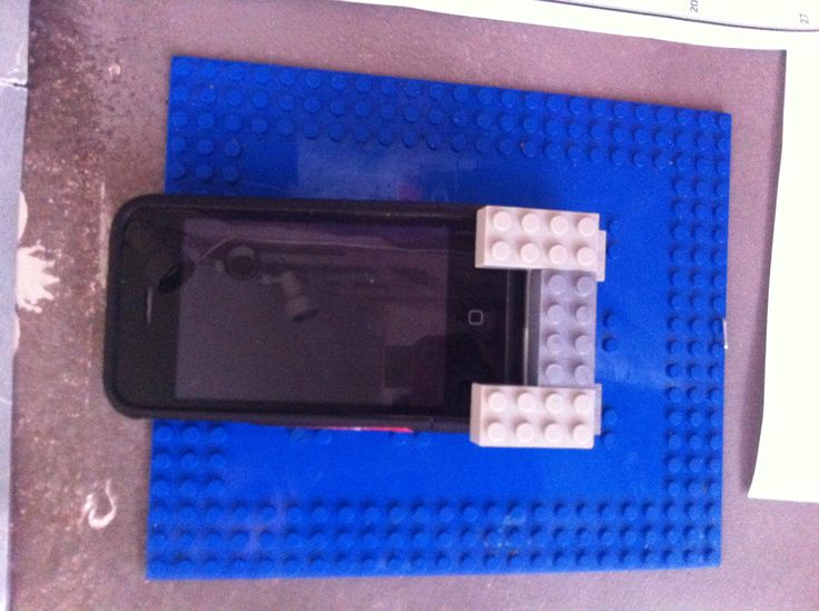 Brother made a iPhone Lego holder for the wall! He also put a charger cord in the back!