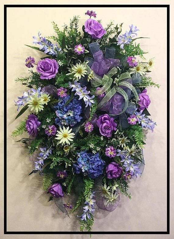 Spring Summer Wreath For Front Door This is a beautiful decorative spring or summer front door wreath. The colors compliment each other wonderfully. It has beautiful blue hydrangeas and freesia along with lavender roses and wildflowers, delicate green daisies with a triple bow