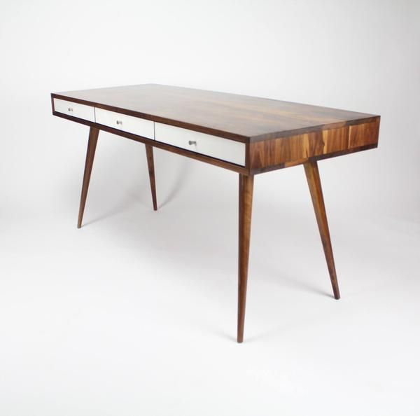"""With the classic Mid Century style, gloss white or walnut drawers, and a 8"""" cable managementcubby in the back, this is the desk for you. Keep your home officespace neat andtidy!!  The three hardwood drawers provide ample storage space andride on soft-close glides to give it that high end touch. The desks sits on solid walnut or oak tapered legs that bolt in to a heavy wood cleats for sturdiness and longevity. This deskis available in solid walnut or white oak.   • 48 L x 24 W x 29…"""
