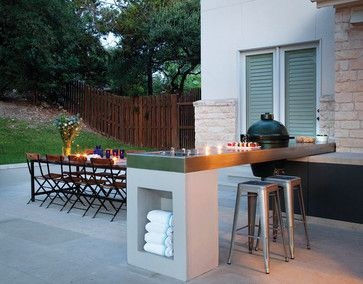 13 Upgrades For Your Outdoor Grill Area: Go for a built-in or just set up a bar-height outdoor table and chairs.