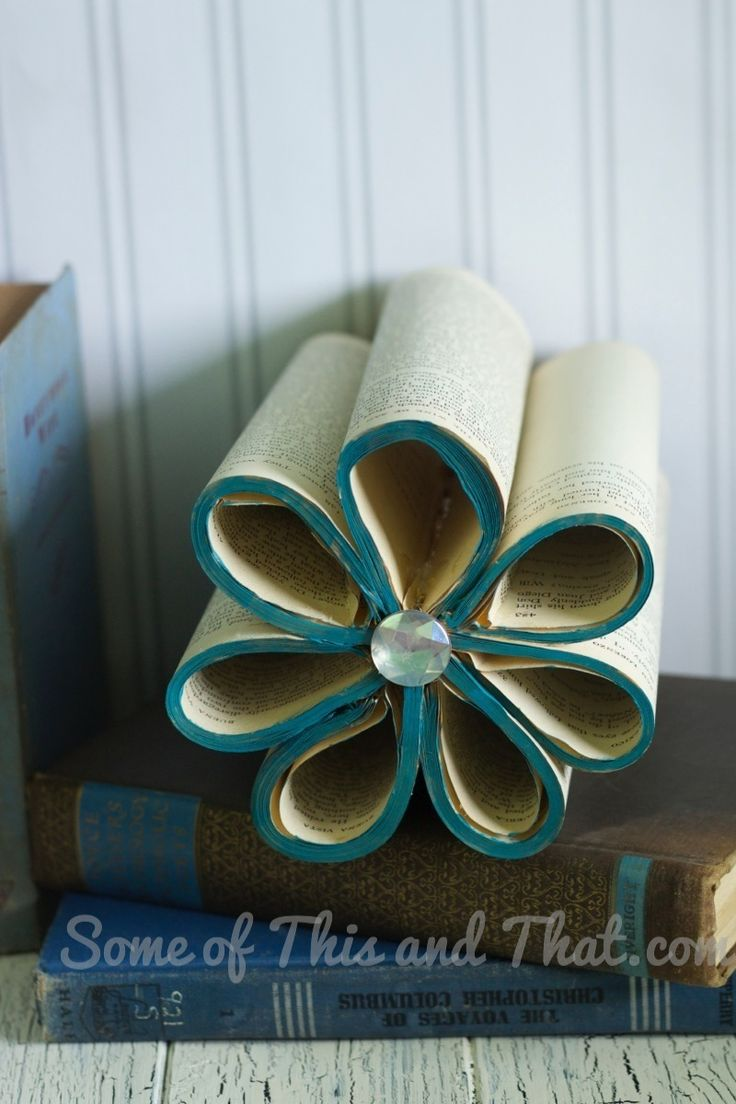 These super cute DIY Book Flowers are an inexpensive way to give a new purpose to an old tattered book. Step by step photos and instructions!