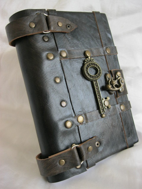 Luxury handmade vintage look blank leather journal notebook with a decorative key emblem. $74.99, via Etsy.