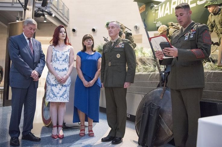 Left to right: Dave Gettings, Cori Gettings, Julie Gettings and Marine Corps Gen. Joe Dunford, chairman of the Joint Chiefs of Staff, listen as Sgt. Maj. Christopher Cary, the sergeant major of the 2nd Battalion, 6th Marine Regiment, reads the Silver Star Medal citation for Marine Corps Cpl. Albert Gettings at the National Marine Corps Museum in Quantico, Va., July 7, 2017. The presentation was part of the 100th Anniversary Mess Night for the unit. DoD photo by Navy Petty Officer 2nd Class…