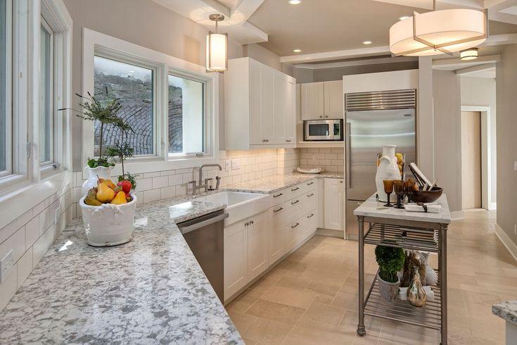Contemporary Kitchen with Flush, L-shaped, Complex granite counters, flush light, Peppercorn White Quartz Countertop