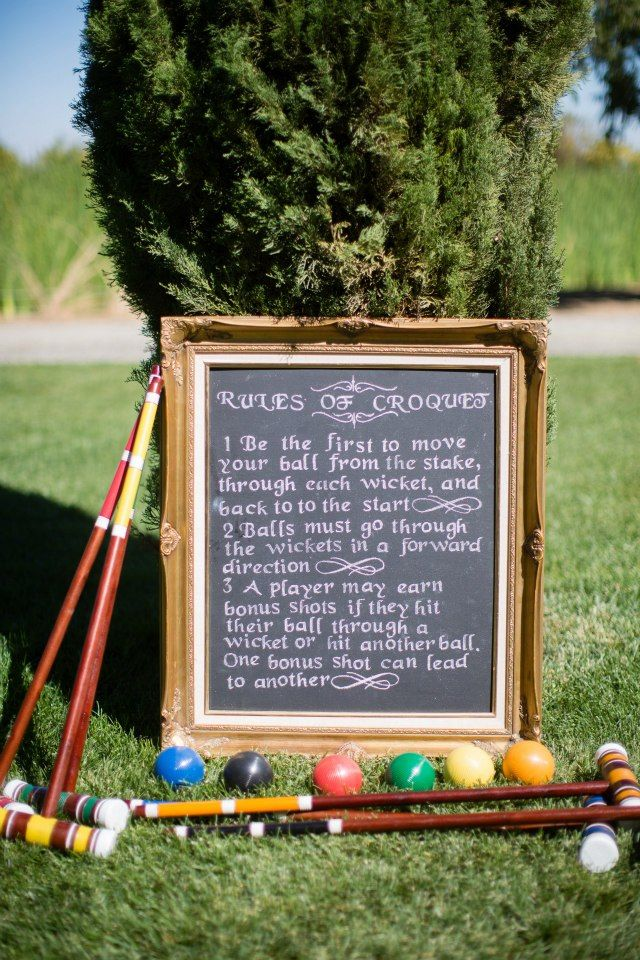 Chalkboard sign for croquet rules. Apparently, players take turns in the designated order which is based on the colors on the club handle....