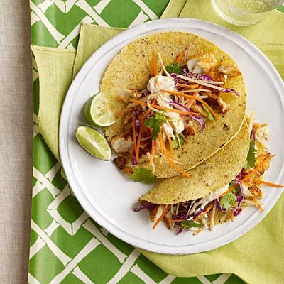 Fish Tacos with Cabbage-Carrot Slaw and Spicy Crema | health.com