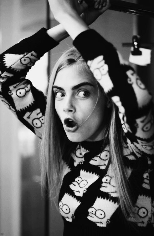 black & white Cara doing the Bartman. #CaraDelevingne #offduty