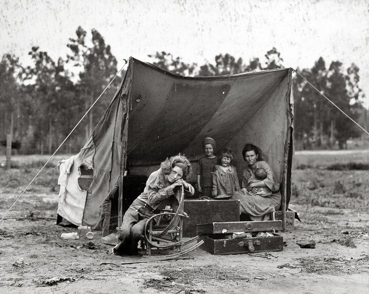 """A migrant mother, 32, who has seven hungry children, living in a tent camp in Nipomo, California, March 1936. The mother is the famous subject of a Depression-era portrait by Dorothea Lange known as """"Migrant Mother."""" She came forward in the late 1970s and was revealed to be Florence Owens Thompson. She died in 1983. That photo is elsewhere in this collection."""