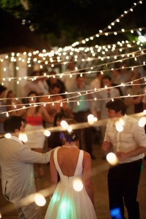 string lights over dance floor -
