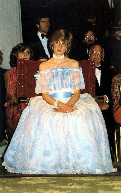 A very tired Princess Diana. Despite some would think being in that southern bell dress would explain it her 'bored' look, she was actually pregnant with William at the time and a short moment after this was taken, she fell asleep. . . pregnancy will do that to you. . .