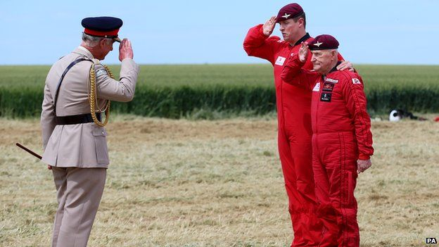 Prince Charles saluting Jock Hutton before his parachute jump. Jock Hutton jumped in to France on D-Day 6th June 1944. Today, at 89 years old, he did it again, albeit strapped to a modern day paratrooper. Incredible. #DDay