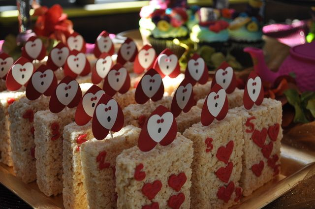 Rice Krispie Treats at a Alice in Wonderland Party #aliceinwonderland #treats@Michelle Stemm I can punch these hearts