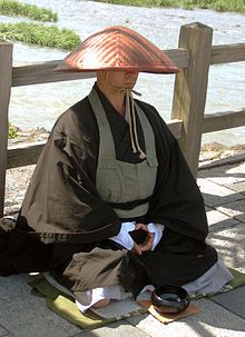 Japanese Buddhist monk begging by the roadside in Kyoto, Japan.   photo credit: Ariyama-san.