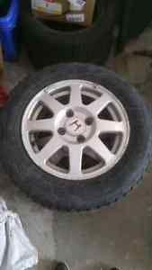 195 65 15 Winter tire with alloy rims Mississauga / Peel Region Toronto (GTA) image 1