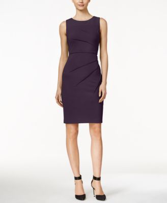 Go from office to dinner in this wear-anywhere sheath from Calvin Klein. | Polyester/spandex | Dry clean | Imported | Scoop neckline | Hidden back zipper with hook-and-eye closure | Sleeveless | Sunbu