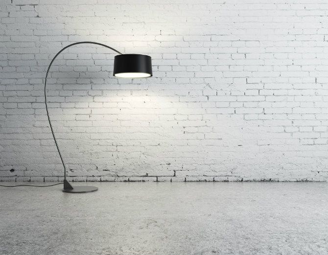 White painted bricks and a black floor lamp | Industrial Design Icons: Floor lamps and brick walls - see the entire article at http://modernfloorlamps.net/industrial-design-icons-floor-lamps-brick-walls/