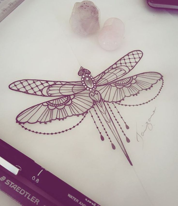 On my thigh, but with a lace garter and this I stead of a bow. Maybe a bit of color in the wings.