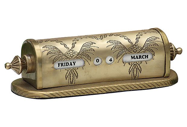 "7"" Brass Calendar   Its antique vibe defines this cool throwback calendar; fashioned in brass, it's a unique desk accessory. Dimensions: 7"" x 2.5"" x 2"" OneKingsLane.com"
