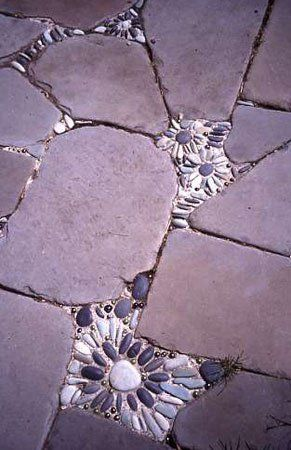 Do you have cracks & crevices in your concrete pathways ? Here is an idea to fix & beautify the pathways all while making it safer. Add concrete then press pebble stones in, let dry.