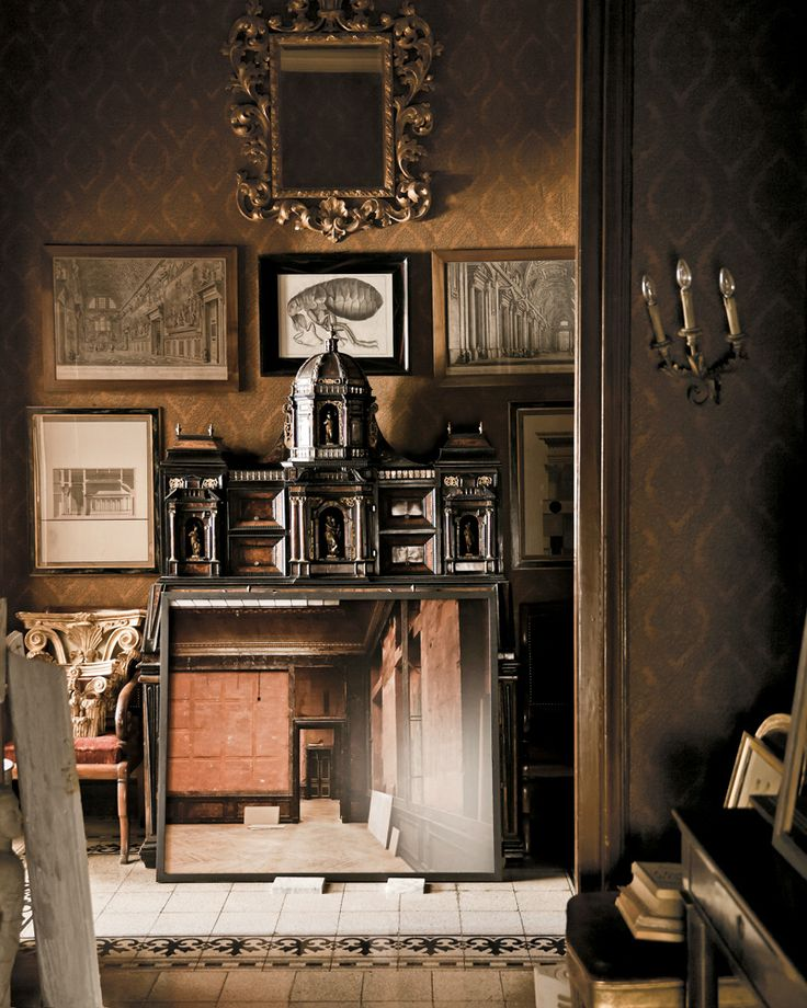office entryway with Massimo Listri print and a baroque cabinet | at the Milan interiors firm Studio Peregalli