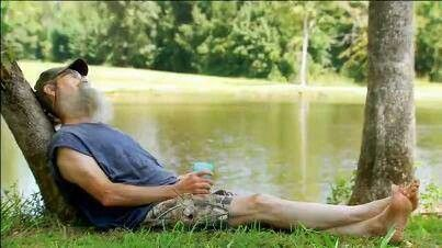 Uncle Si Robertson taking a nap with his tea glass in his hand, lol