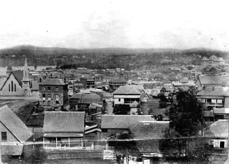 View over Spring Hill, Brisbane, ca. 1868 - View taken from Leichhardt Street looking at Astor Terrace in the foreground and towards the Wickham Terrace Presbyterian Church on the corner of Wickham Terrace and Creek Street. At the extreme right in the middle distance is the first Temperance Hall in Edward Street.
