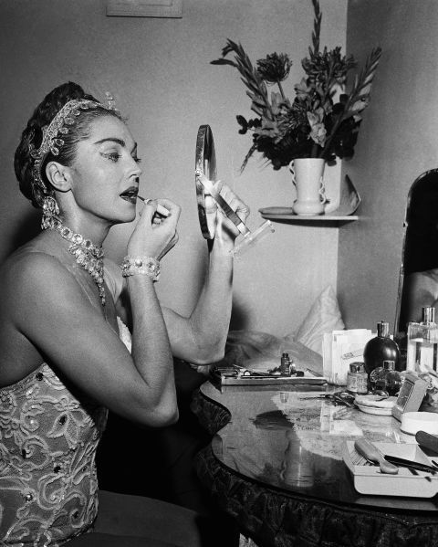 The famous swimmer/actress Esther Williams does some last minute touch-ups in her sparkly outfit.