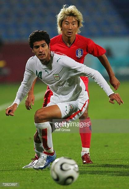 Saeid Chahjouee of Iran and Lee Chun Soo of South Korea battle for the ball during the Men's Football Bronze Medal Match in the 15th Asian Games at...