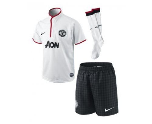 Manchester United Boys Away Football Kit 2012/13 by Nike. $58.04. The new Manchester United Away Boys Football Kit is a stylish new design for the 2012/13 season. The away kit is part of the new Gingham collection. The kit consists of a shirt, shorts and socks and is a full replica kit. The shirt is white in colour with black details. There is a discreet button up collar with red trims. It is 100% polyester and has short sleeve. There is a black embroidered Nike logo an...
