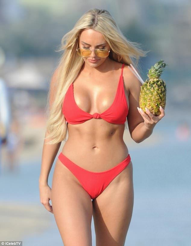 b9e6299d990 TOWIE s Amber Turner flaunts her incredible figure in a skimpy bikini