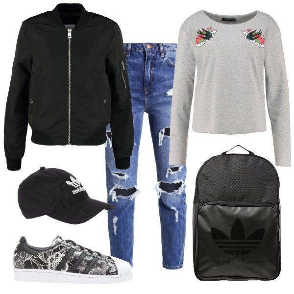 Il look scelto da un adolescente, ideale per raggiungere la scuola. Una felpa comoda, jeans strappati. Il bomber nero si abbina agli accessori dello stesso marchio, dal cappello con visiera, allo zainetto ed alle scarpe, scelte con una fantasia a fiore in pizzo per dare un tocco di femminilità allo stile.