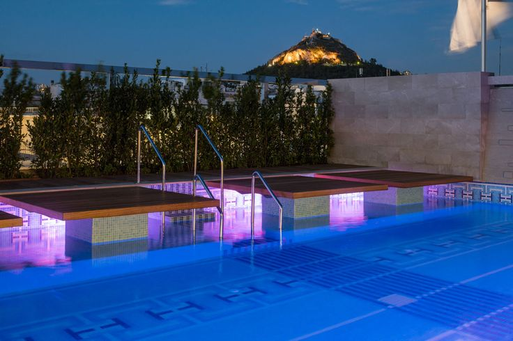 The pool with Lycabettus hill views at Electra Metropolis Athens.