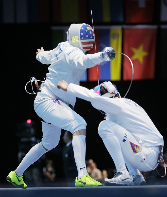 The United State's Seth Kelsey, left, competes against Venezuela's Silvio Fernandez during the men's individual epee fencing competition at the 2012 Summer Olympics, Wednesday, Aug. 1, 2012, in London.(AP Photo/Dmitry Lovetsky)