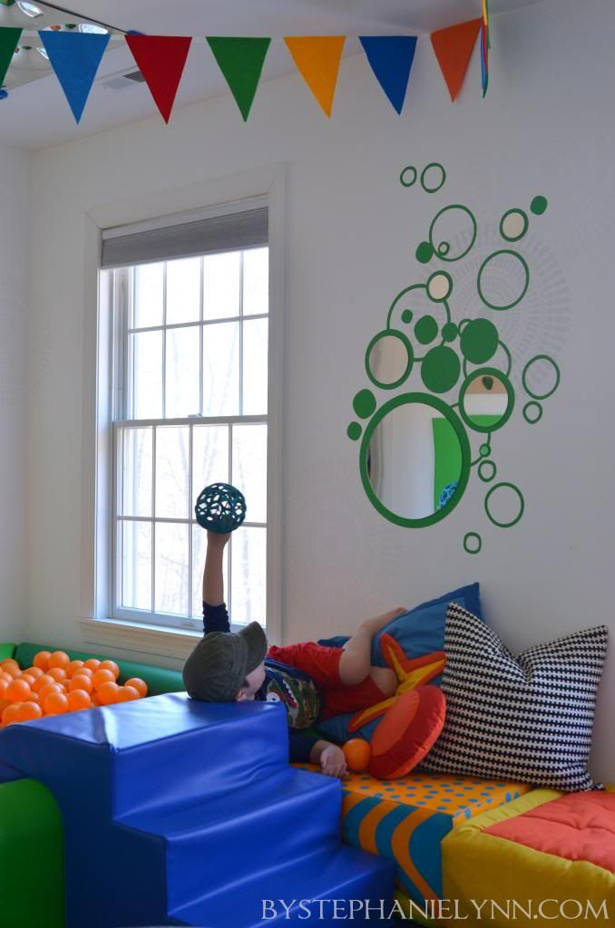 Kid Friendly Wall Art for an Indoor Sensory Playroom - bystephanielynn Vinyl wall decal from dezignwithaz.com plus acrylic (not glass) mirrors.