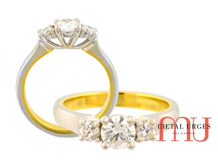 Stunning handmade three diamond four claw set engagement ring. The three GIA certified round brilliant cut white diamonds are individually four claw set in 18ct white gold with single under rails. The 18ct white gold ring band features an 18ct yellow gold lining. From the Hobart workshop of Metal Urges Tasmania in Australia.