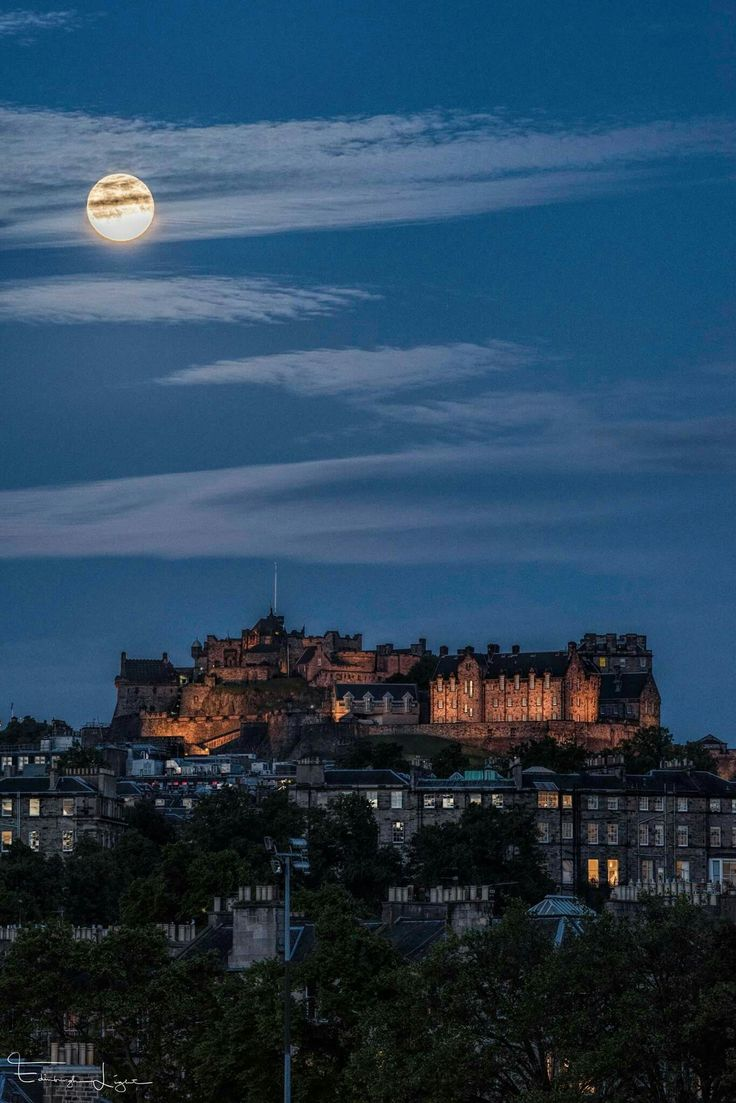 Solstice moon over Edinburgh Castle Photo by Jonathan Cruikshank