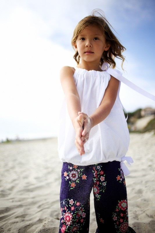 Bubble top little girls white shirt. So cute! Same as a pillowcase dress but shorter & with a tie at the bottom!
