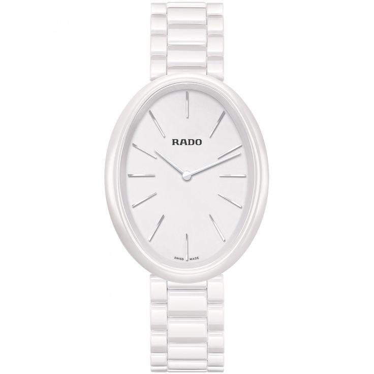 Reloj Rado de caja bisel y extensible en cerámica color blanca; carátula a tono con manecillas e indicadores luminiscentes; nombre de la marca.