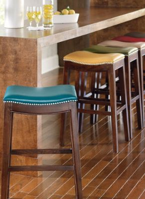 Classic Leather Bar Stools.  These are a bit pricier, but would sure add some color to the kitchen.
