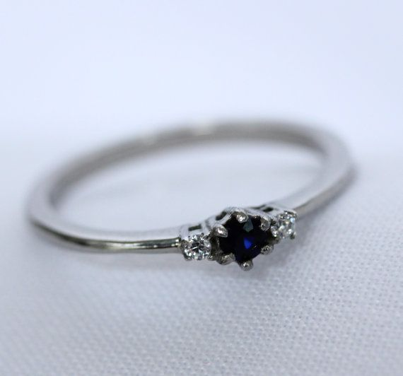 Buy Natural Blue Sapphire and White Sapphire 3 stone Trilogy Ring in White Gold or Titanium - engagement ring - handmade ring by thealaddinscave. Explore more products on http://thealaddinscave.etsy.com