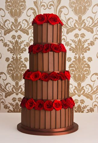 "'Belgian' chocolate wedding cake: Chocolate fudge cake,   Amedei Toscano chocolate buttercream,   Belgian chocolate plaques.    Price as shown:  4 tiers (6"", 8"", 10""  12"")  £995 + flowers"