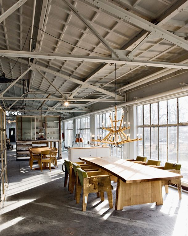 Dutch designer Piet Hein Eek found an abandoned factory space on the outskirts of Eindhoven, and converted it into his studio, shop, gallery, restaurant, event room, factory, and atelier for designers. Inspiring space.