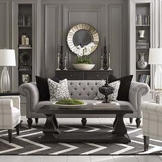 Accent Chair/ Chesterfield sofa. LOVE THIS. Maybe it's the English woman in me but this sofa spells comfort, home, elegance and good design. LOVE those cushions too.