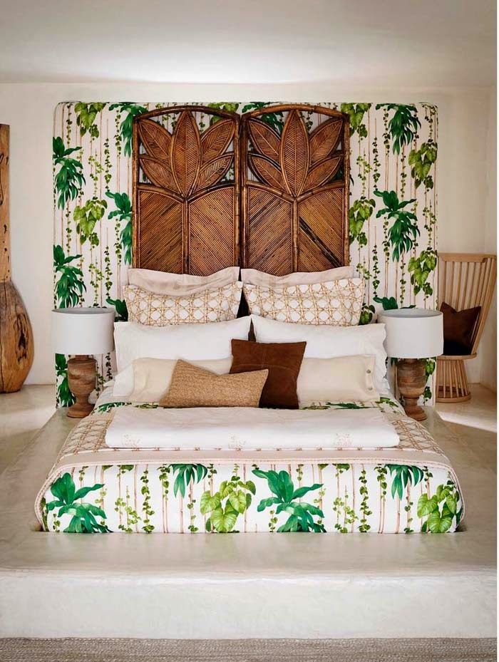 A beautiful palm headboard and bedding to take you into paradise