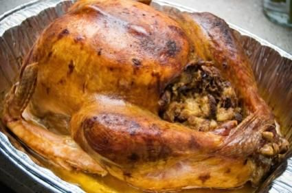 Stuffed turkey in roasting pan - convection oven- we used a bag, filled with water, thermometer  and took it out at at 163 degree then convection broiled out of bag ~10 mins