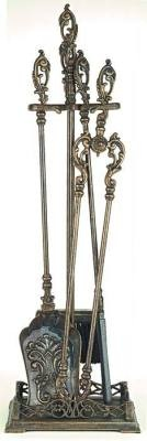 """At long last, a beautiful departure from the standard fireplace tools. An ornately handled Italian brass set includes a wrought iron tipped poker, horse hair broom, shovel and log tongs... everything needed for a cozy fire in the hearth room. Stand measures 31"""", Tongs 26"""", Broom 251/2"""", Poker 271/2"""", Shovel 27""""."""