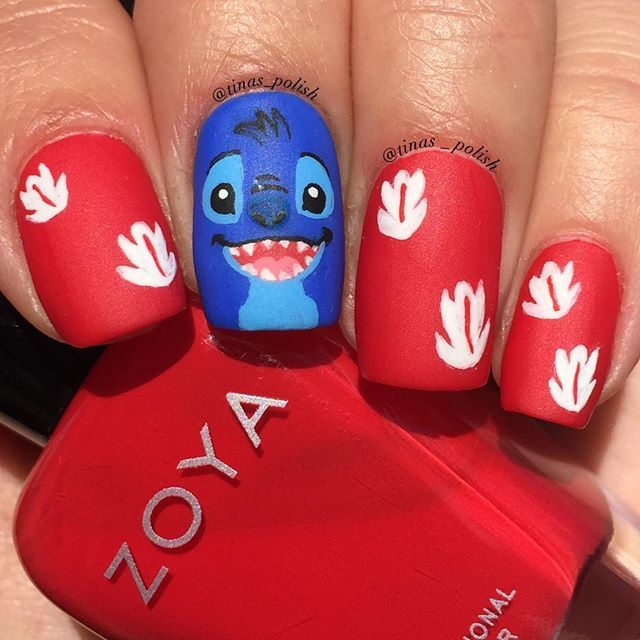 """Instagram media tinas_polish - Here is the finished Stitch mani. I was going to include Lilo, but I knew I wasn't going to have time to finish her, so I just painted her leaves/flowers from her dress.  Base for Stitch is : Sally Hansen •Pacific Blue• (original formula)  Red is @zoyanailpolish •America•  Matte top coat: """"Polish Matte'rs""""(my favorite matte) which I purchased through @girlybitscosmetics  The rest was done with acrylic paints and my brushes from @stylishnailartshop"""
