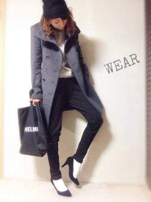 Black pumps, white socks, black trousers, long grey coat, black wool hat